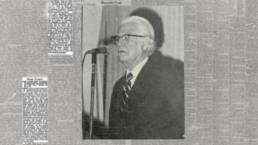 maxwell maltz standing at microphone